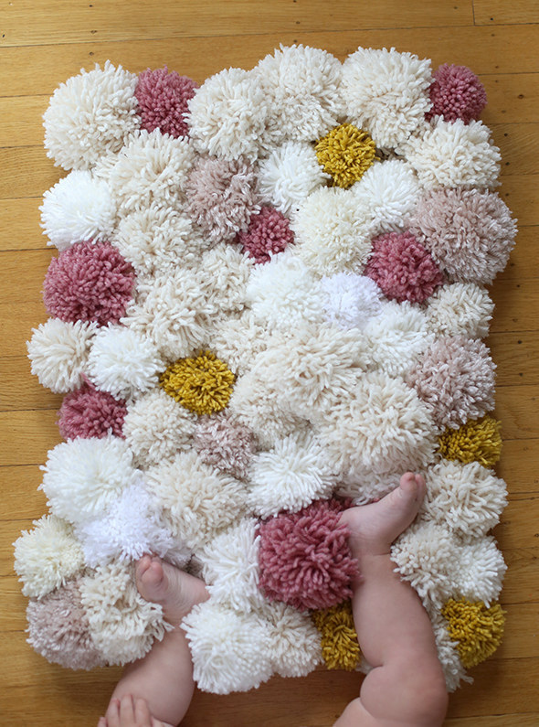 Make cold tile floors 110% cozier with a pom-pom rug DIY.