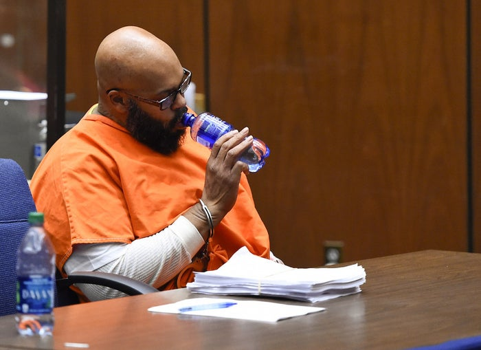 Suge Knight drinks water as he appears in court for a bail review hearing in his murder case in Los Angeles on Friday.