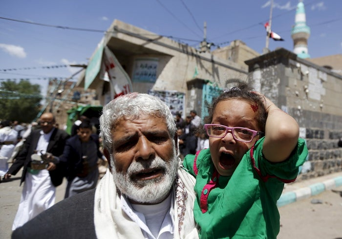An injured girl is carried out of one of the attacked mosques on Friday.