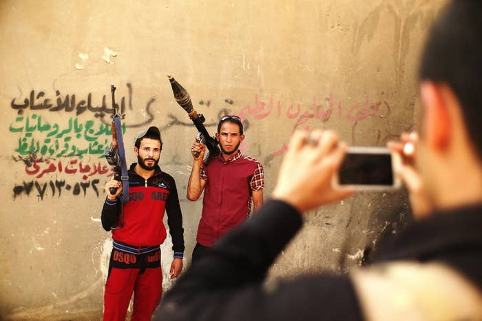 Men pose for pictures after joining a Shiite militia in Baghdad's Sadr City on June 14, 2014.