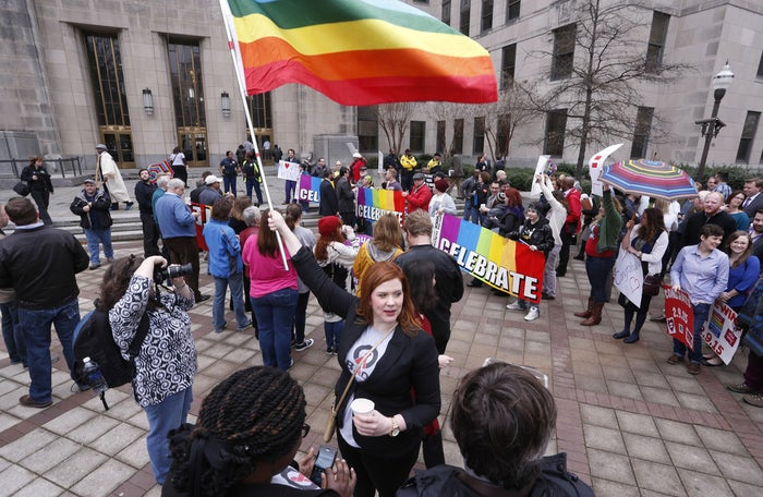 Amanda Keller holds a flag as she joins other marriage equality supporters in Linn Park, at the Jefferson County courthouse, Monday, Feb. 9, 2015, in Birmingham, Ala.