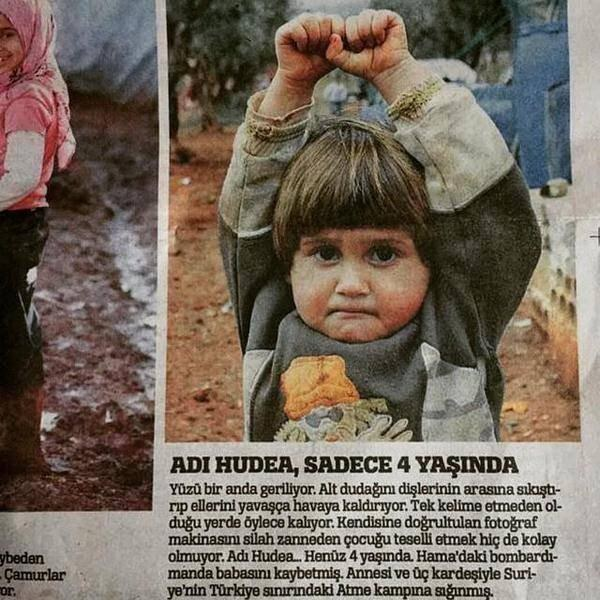 "A Picture Of A 4-Year-Old Syrian Girl ""Surrendering"" To A Photojournalist Has Gone Viral"