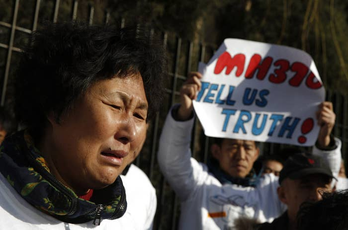 A woman cries during a gathering of family members of the missing MH370 passengers outside the Malaysian embassy in Beijing March 8.