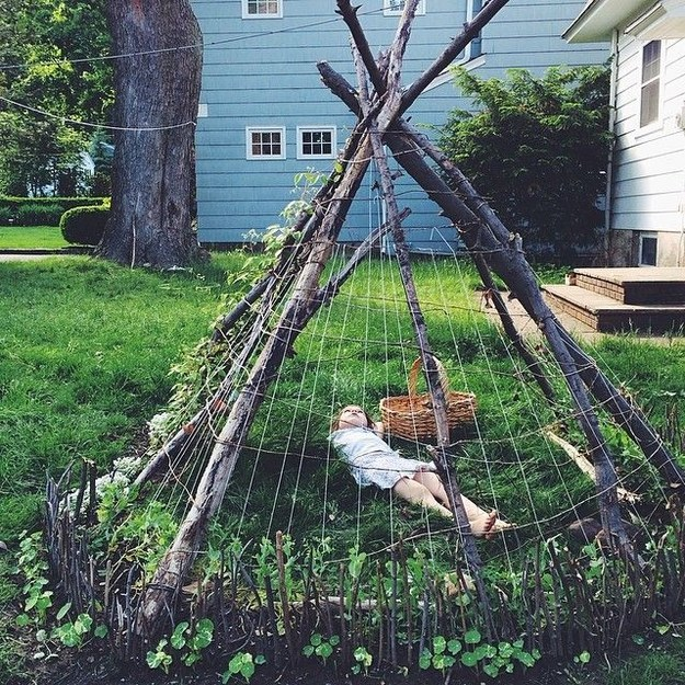 child laying in teepee in backyard ideas