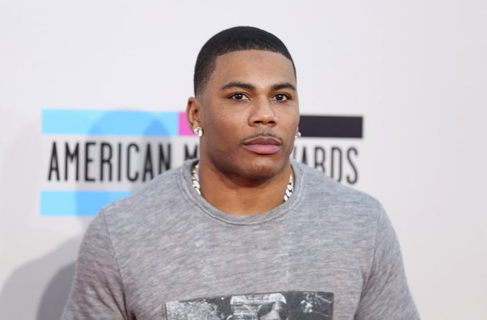 Nelly arrives at the 2013 American Music Awards, on Sunday, Nov. 24, 2013 in Los Angeles.