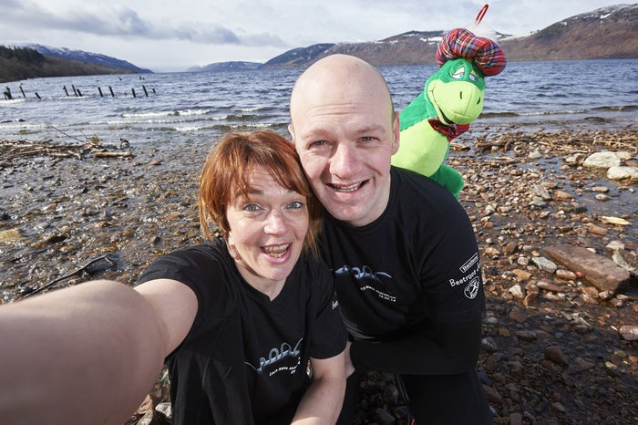 Diana Mitchell and Gordon Lloyd, of the JogScotland Inverness running club, with Nessie.