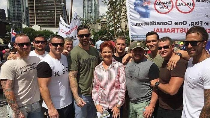 The photograph that got Nauru detention centre guards suspended. Pictured from left: Dan Connors, Cody Allen, Alan Hartley, Beau James, former politician Pauline Hanson, Graham Motley, Simon Scott, (the next man in the green shirt is not a Nauru detention centre employee), Jamie Scannell and Harley Levanic.