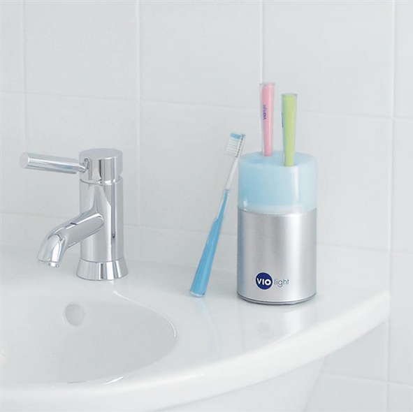 14. This Toothbrush Holder That Will Also Sanitize Your Brushes Between  Uses.