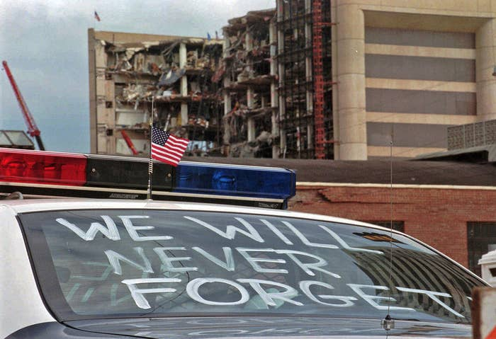 """An Oklahoma City police car decorated with the words, """"We will never forget"""" on April 24, 1995."""