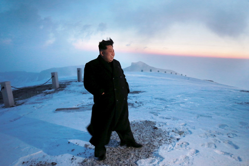 """Kim Jong Un """"Scales North Korea's Highest Peak"""" In Leather Shoes And An Overcoat"""