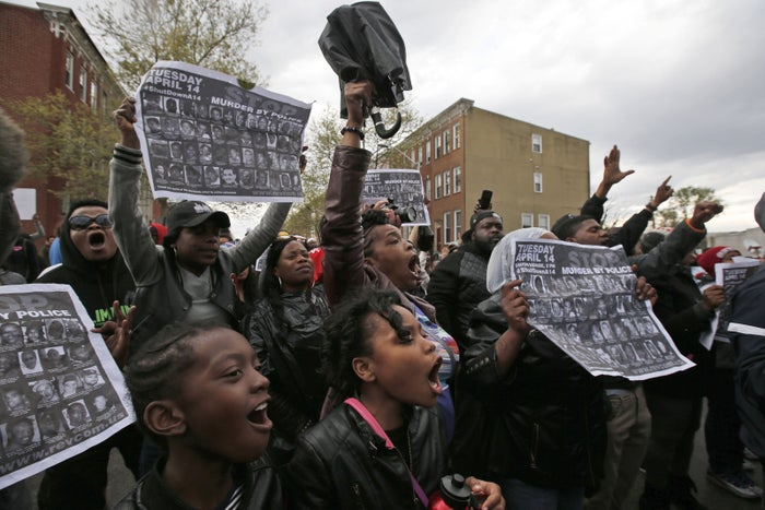Marchers near the Baltimore police department's Western District police station on Wednesday.