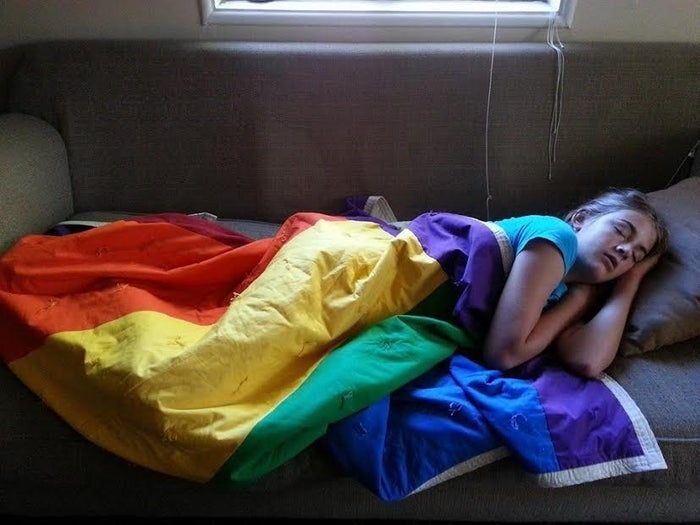 Kate Reese naps under an LGBT pride flag.