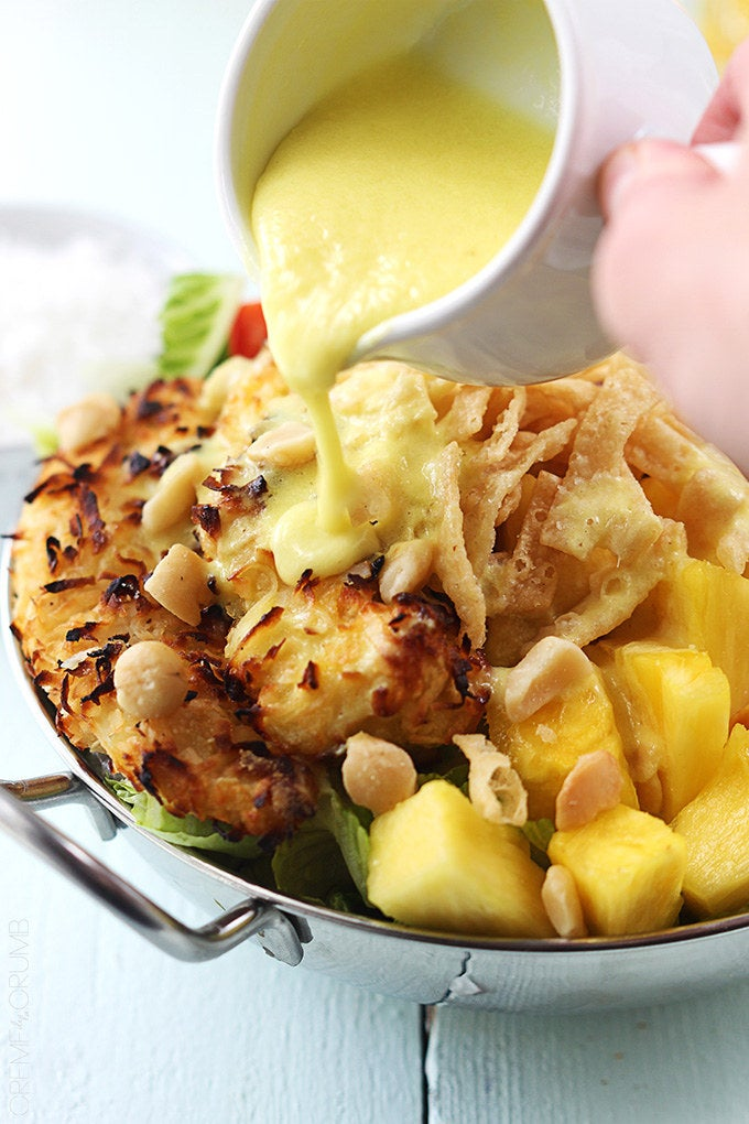 With a piña colada vinaigrette. This salad will instantly make you feel like you're on the beach sipping a real piña colada.