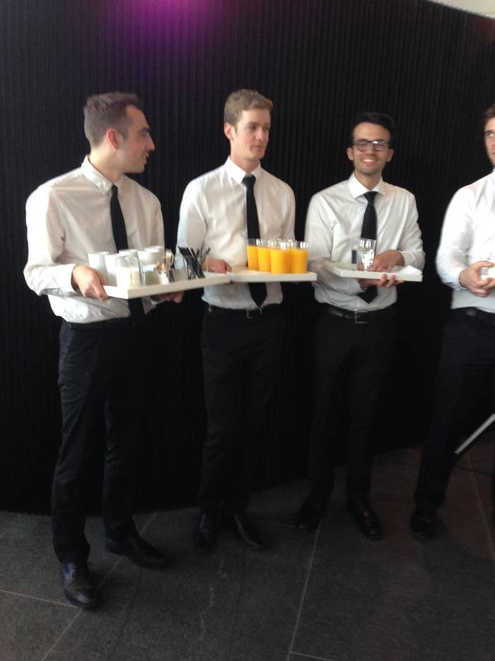 Waiters with coffee, juice, and seltzer.