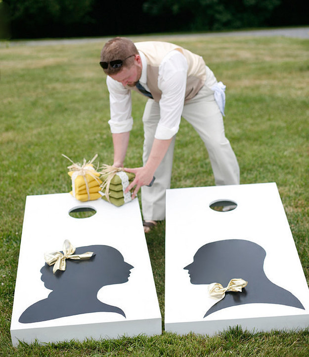 For an outdoor wedding, cornhole toss is a blast.