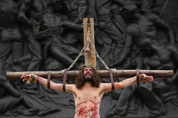 Actor James Burke-Dunsmore hangs on the cross as Jesus during the Wintershall's The Passion of Jesus production on Good Friday in Trafalgar Square on April 3, 2015, in London.