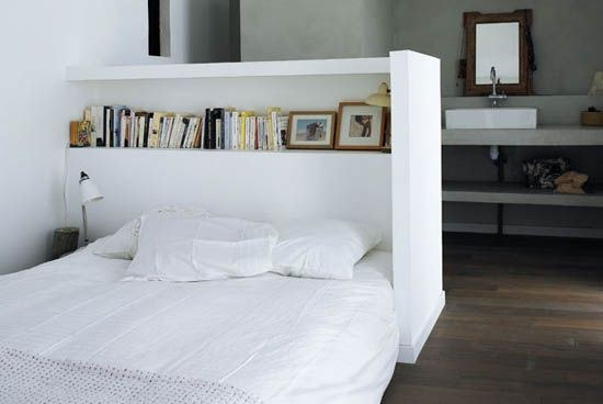 Use a bookcase as a headboard.
