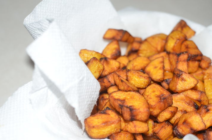 """What it is: Pronounced """"doh-doh"""", these are deep fried plantains (not bananas), cut in slim diagonal slices, circles or cubes (colloquially known as """"party dodo"""") and deep-dried. Some people like to sprinkle some salt on before frying, but that's down to personal taste. It's a snack, a side dish, a main meal, a blessing.Why it's awesome: It tastes like a mother's love. It's impossible to cook it badly. It's both a whole meal and a side dish. It is the best thing.You don't really need a recipe for this: just peel, chop and fry. Crack open a Supermalt and eat it on the veranda."""