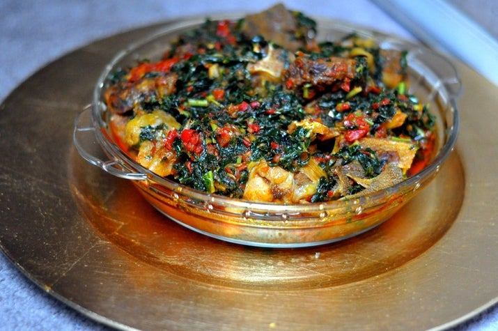 """What it is: A literal translation from the Yoruba is """"mixed greens"""" and while they are the star of this rich, fragrant vegetable stew, there's so much goodness besides: blended scotch bonnets, bell pepper, onions and locust beans. This is a classic Yoruba dish.Why it's awesome: It goes with everything. Purists insist authentic efo riro must have efinrin (African spinach) and efo soko (Lagos spinach). Others say tomatoes are banned (to prevent sogginess). Some insist on palm oil over vegetable oil. All agree it's freakin' delicious.You can find recipes here, one with tomatoes here, and a variation that uses kale here.If you're interested in some of the scores of green leafy vegetables used in a lot of Nigerian cooking, here's a handy list."""