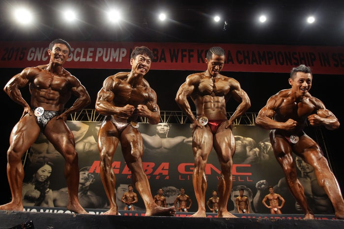 Contestants pose for judges during the NABBA WFF Korea Championship in Seoul, South Korea.