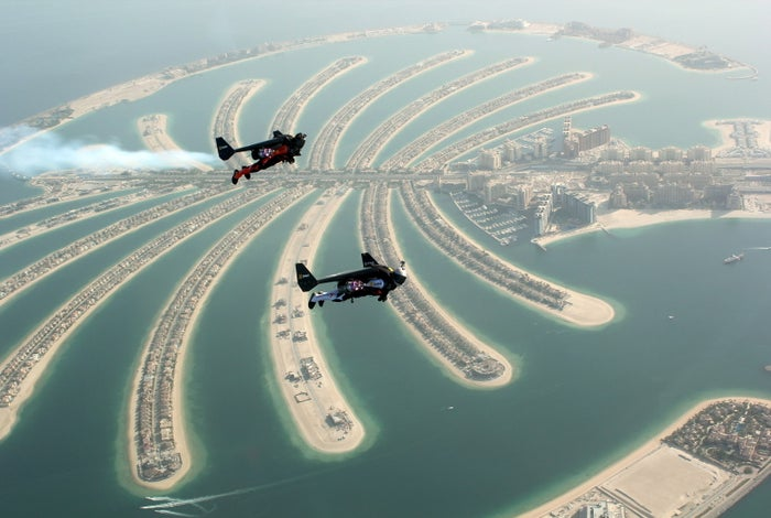 An aerial view taken from a sea plane shows Swiss pilot and original Jetman Yves Rossy and Vince Reffett flying over Dubai's Palm Island, Dubai, United Arab Emirates.