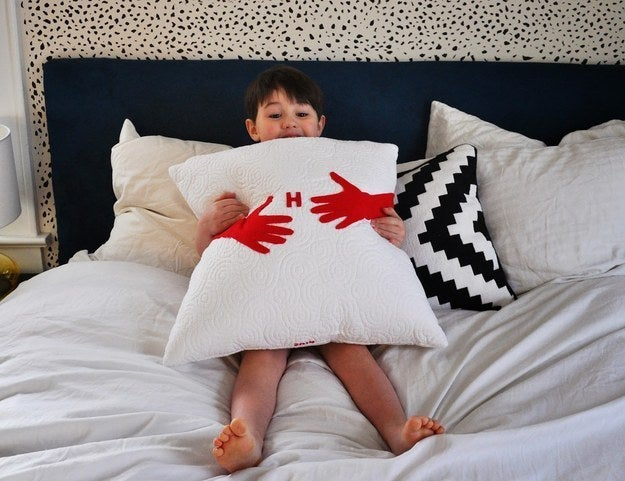 Trace and cut out felt arms and hot glue them to your favorite pillow. Check out the full tutorial here.