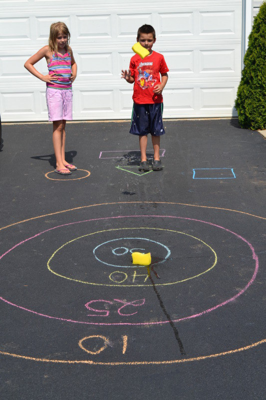 Dollar-store sponges and chalk are all you need to turn your driveway into a bull's-eye target game.