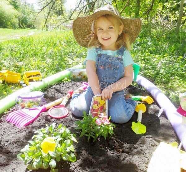 You can plant seeds or hide dollar-store toys in the soil and let your kid dig for them. Learn more here.