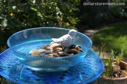 A serving tray and bowl make a charming birdbath.