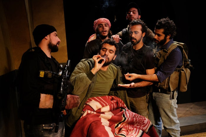 The cast rehearse a scene where they share a cigarette.