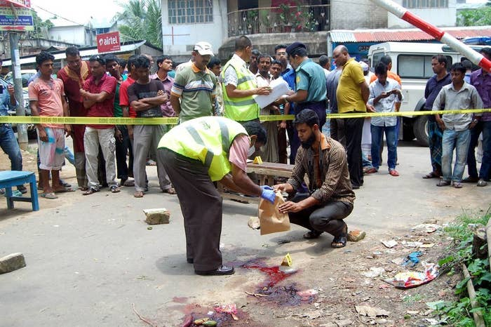 Bangladesh forensics police investigate the site where a blogger was hacked to death. May 12, 2015.