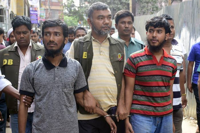 Bangladeshi police escort two men accused of the murder of blogger Washiqur Rahman to a court appearance in Dhaka. March 31, 2015.