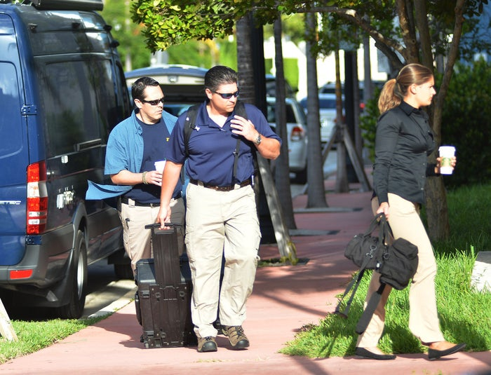 FBI agents prepare to enter the offices the soccer federation that governs North America, Central America, and the Caribbean in Miami Beach, Florida.