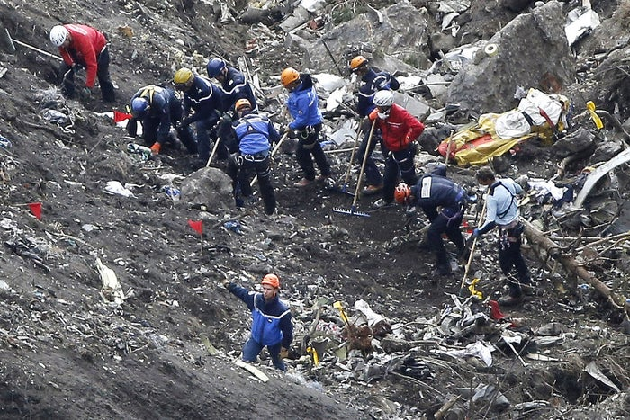 In this March 26 file photo, rescue workers sift through debris of the Germanwings jet at the crash site near Seyne-les-Alpes, France.