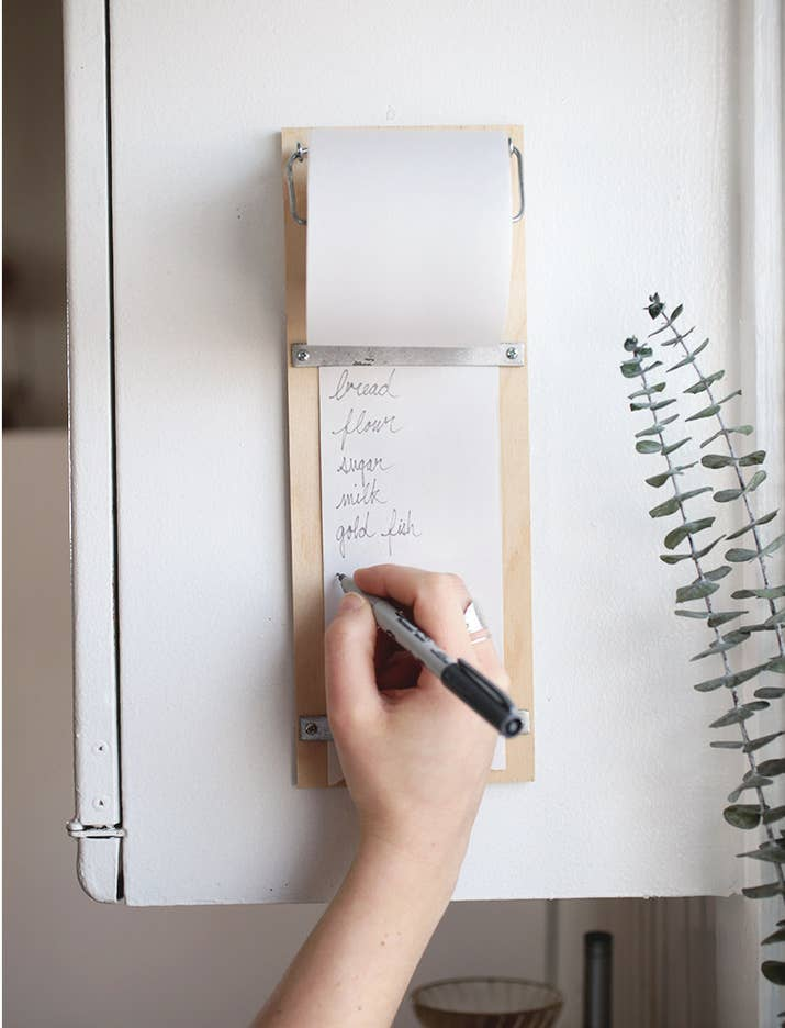 Installing it right beside the fridge is ideal, so everyone (young and old) will remember to add things to the shopping list as they run out or expire. Full tutorial at The Merry Thought.