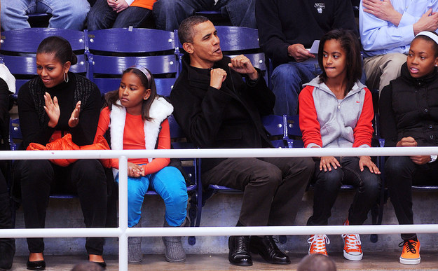 2010 - At a basketball game with her family.