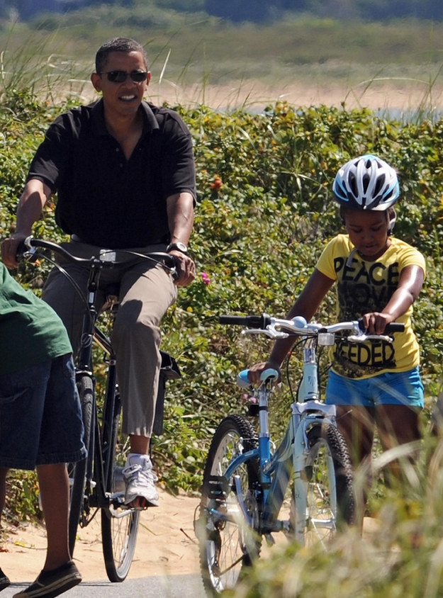 2009 - Riding her bike with her dad in Martha's Vineyard.
