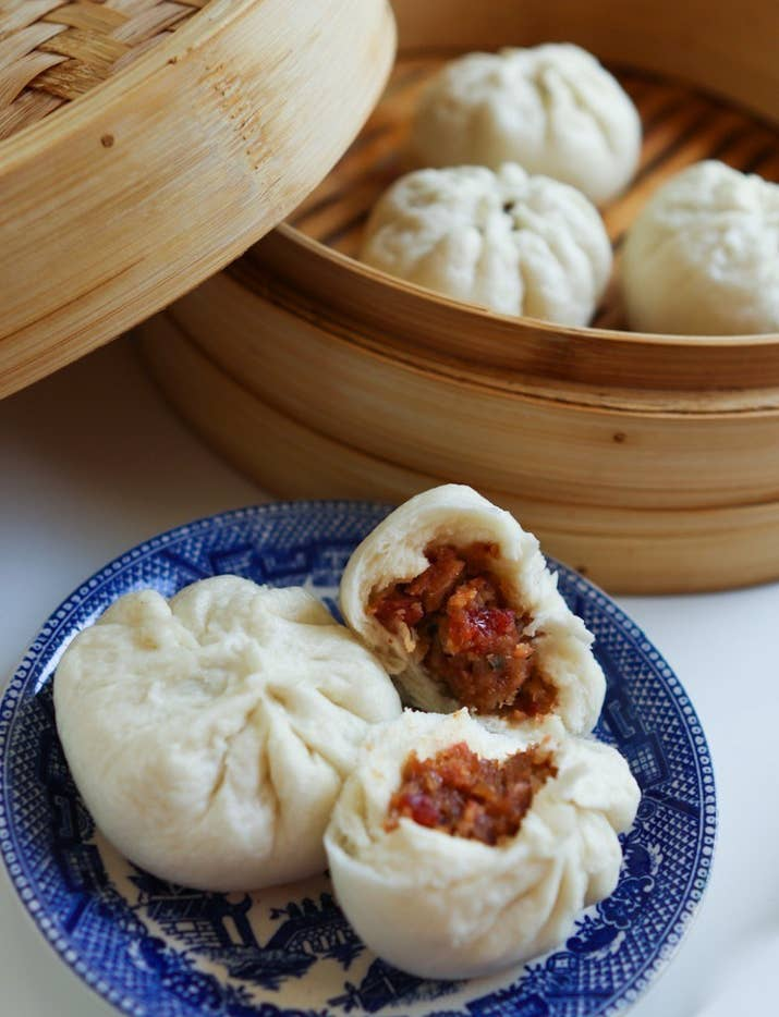 This dim sum standby is like a Cantonese barbecue feast tucked away in a doughy bun.Country: ChinaTypical Filling: Barbecued pork.Recipe: Steamed Char Siu Bao