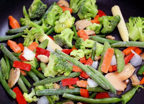 """Frozen is a great choice when it comes to vegetables, as they are frozen at the peak of freshness,"" Jones says. ""I tell my patients to keep some veggies in the freezer and try to find ways to add them into everyday meals. For example, last night I sautéed broccoli and spinach and added it to my homemade pizza."" Jones suggests adding in one cup of frozen veggies to your usual pastas, stir-fries, and omelets for a nutritional boost."