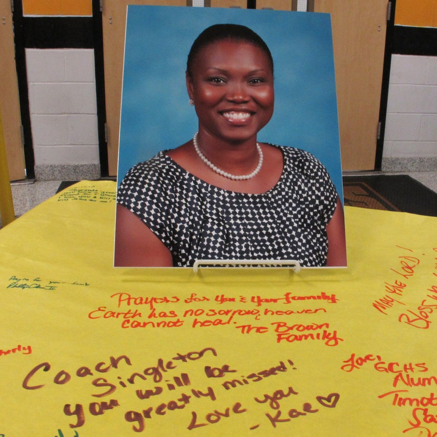 A picture of Sharonda Coleman-Singleton sits on a large paper signed by students, teachers and friends in Goose Creek .
