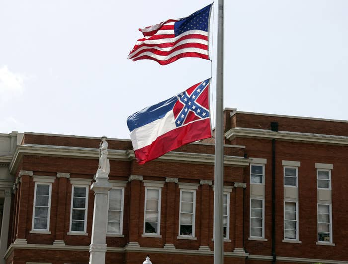 The U.S. and Mississippi state flags.