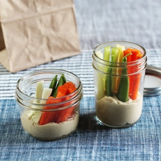 Chop celery and carrots into sticks, and create little hummus and veggie snack jars.