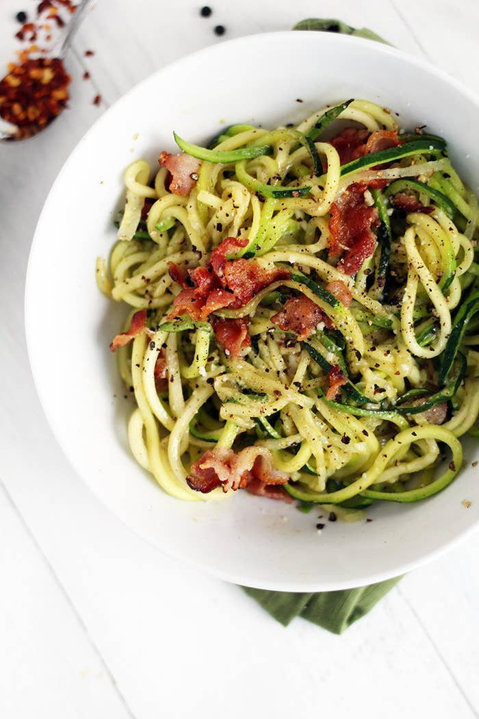 """Cacio e Pepe is a traditional """"cheese and pepper"""" pasta in Italy. Top these zucchini noodles with bacon for a dish so good, you won't even miss the pasta. Recipe here."""