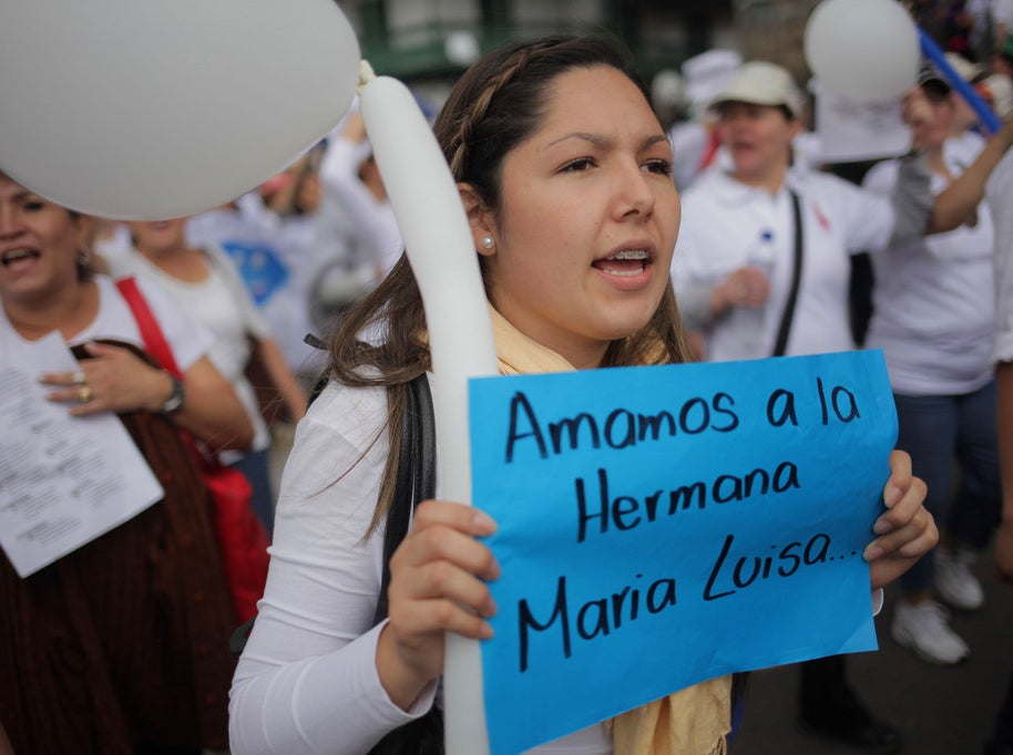 María Luisa Piraquive's supporters march in Bogotá.