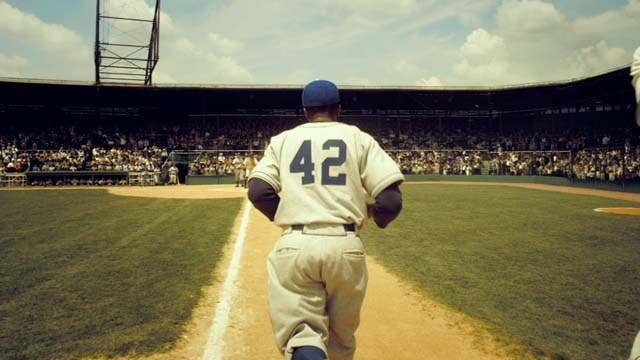 42 tells the story of Jackie Robinson's first year in the Majors as he has to deal with racism in America as he breaks the color barrier. This movie does a great job of showcasing the struggles and challenges Robinson had to deal with as he traveled through segregated America.