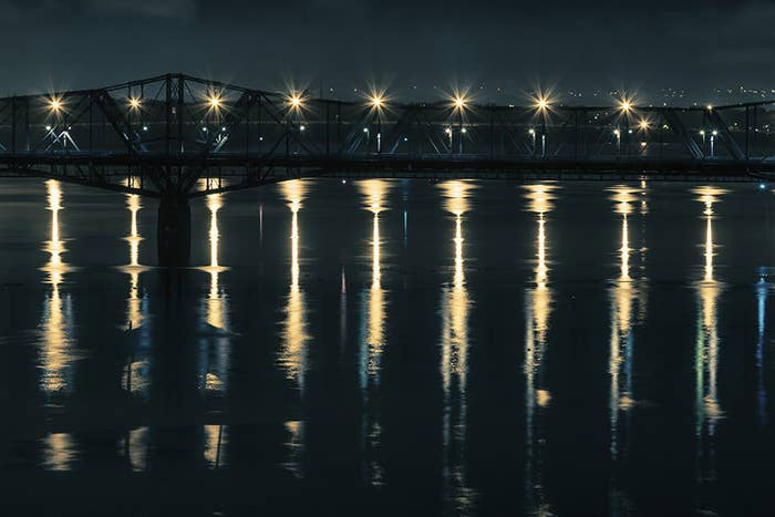 The Alexandra Bridge, gateway between Ottawa and Gatineau, reflects on repeat upon the Ottawa River.