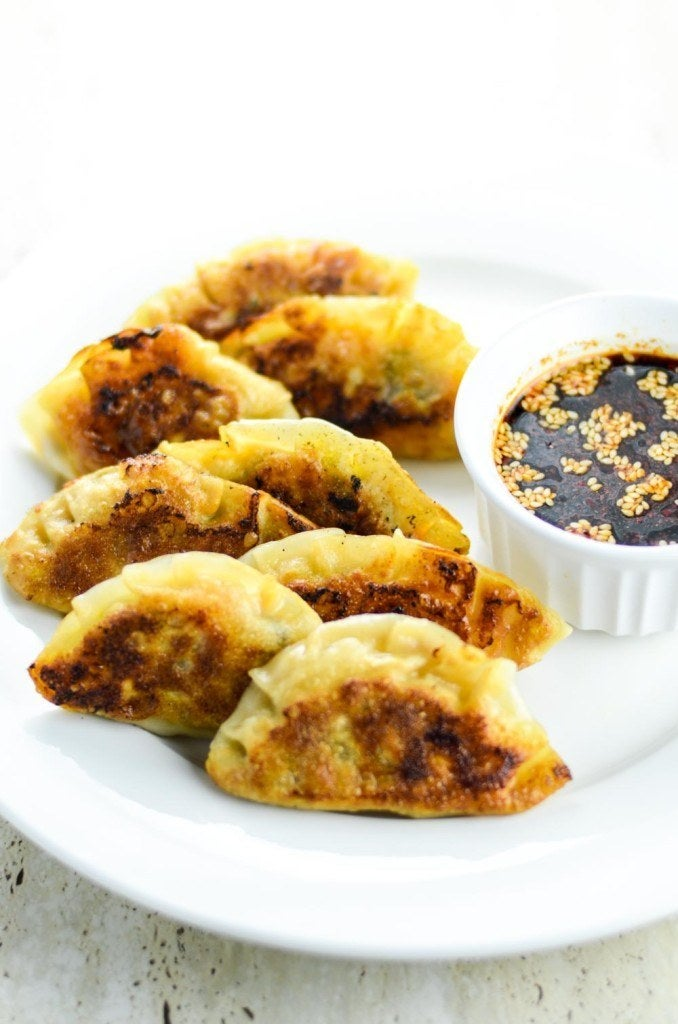 These are the pan-fried potstickers that usually come to mind when you're craving dumplings.Country: JapanTypical Filling: Pork, mushrooms, and cabbage.Recipe: Pan-Fried Chili Pork & Cabbage Gyoza
