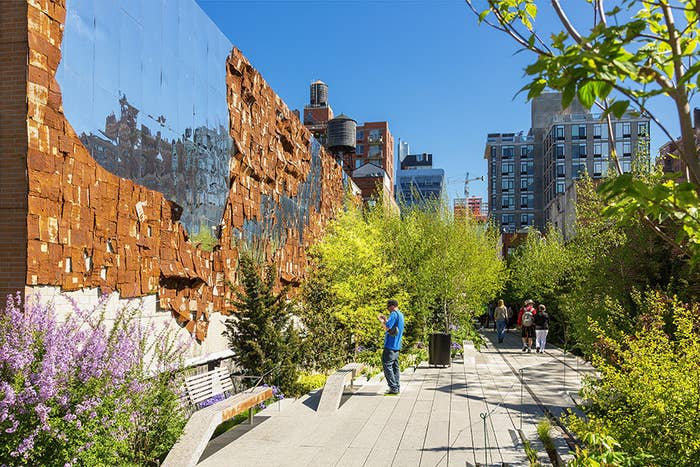 The High Line is a public park built on what was once a freight rail line elevated above the streets of the west side of Manhattan. You can still see the train tracks in certain parts of the park!