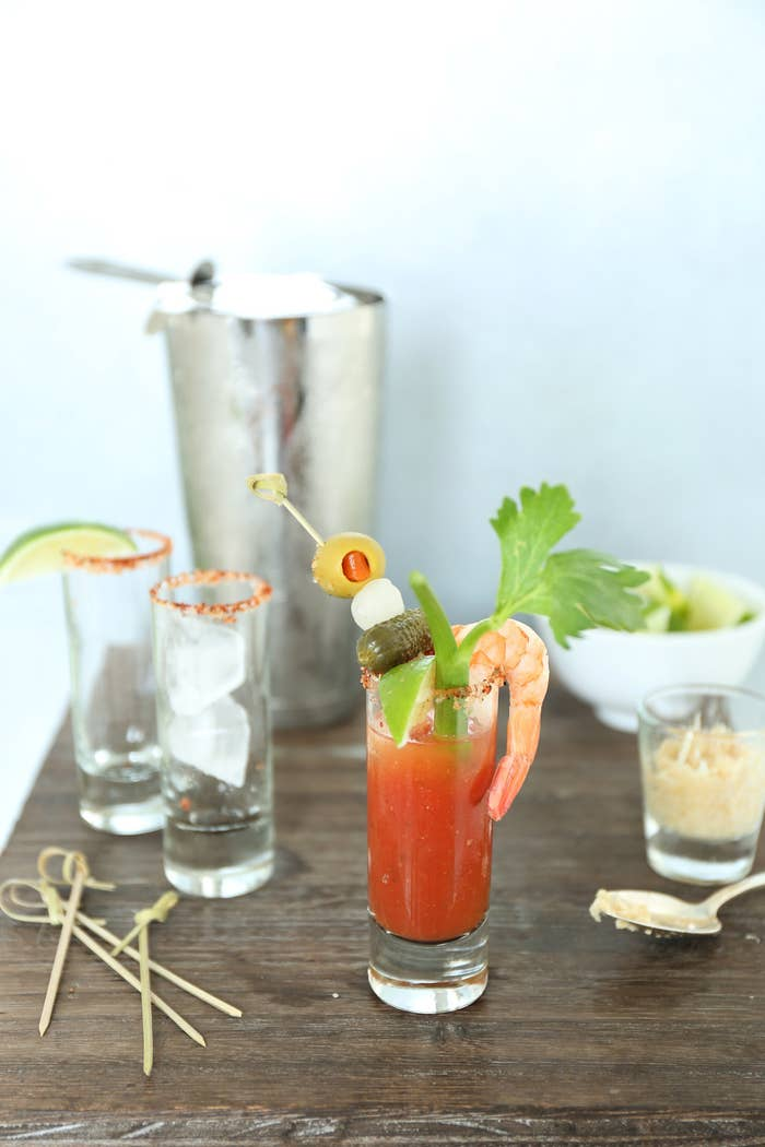 Start your brunch off right without spoiling your guests' appetites by providing sip-sized Bloodys. Your guests can throw a few back without getting full, and DIY their way to the perfect garnish stick.You'll need: vodka, Bloody Mary mix, shot glasses, garnishes (we used cocktail shrimp, celery, lime, cornichons, pearl onions, and pimento-stuffed olives).
