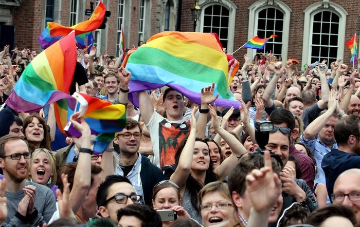 Supporters react outside Dublin Castle after Ireland became the first country in the world to enact marriage equality by popular vote.